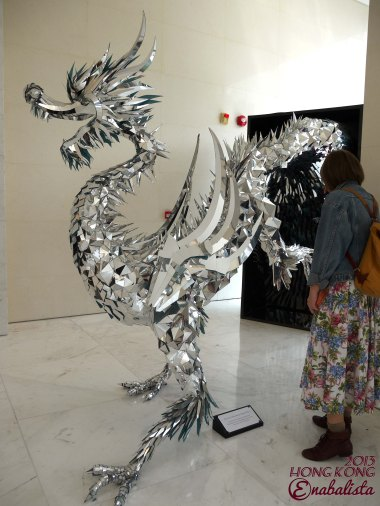 A beautiful Dragon sculpture made up of what looks like silver coloured suede fabric for the previous Dragon year, now placed at Lane Crawford's One Island South office building.