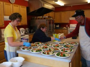 Photo of three members of the Shelburne Association Supporting Inclusion preparing a catering order