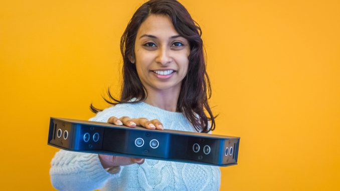 Photo of Dr. Pooja Viswanathan, CEO of Braze Mobility holding their latest product