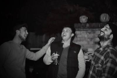 enchanted cinema halloween screening -audience beer wine laugh