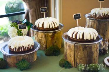 Various bundt cakes on log risers