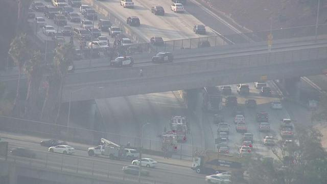 Freeway shut in Hollywood after man threatens to jump off overpass