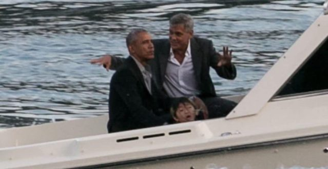 Obama and George Clooney with terrified Asian child in boat