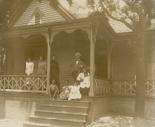 A group on the front porch of the Atlanta home of an African American lawyer, by Thomas E. Askew. He took many of the portraits in the albums.