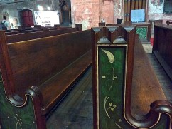 The painted ends of the pews.