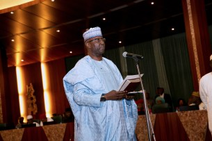 Image result for President Buhari swears-in Boss Mustapha as SGF
