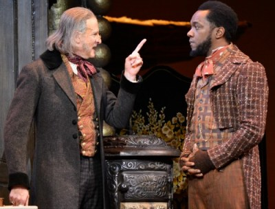 De Vries as Scrooge, Neal A. Ghant as Bob Crachit. Photo: Greg Mooney