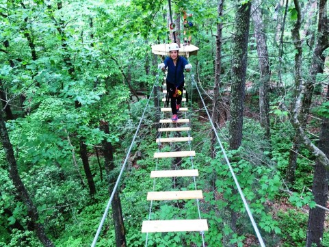 Suspension bridges link some trees on the zip line course. Expect some serious sway but don't fret. You're always tethered to a safety cable. Photo: Phil Kloer