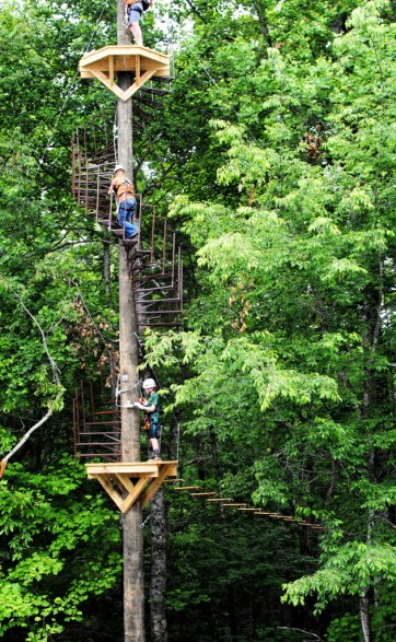 The highest point in the Unicoi course is about seven stories off the ground. Zip liners climb spiral staircases that wrap around trees to reach some of the launching platforms. Photo: Phil Kloer
