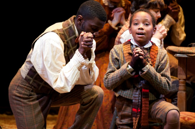 Nicholas Sanders (left) played Tiny Tim in 2011. He's now a student at the DeKalb School of the Arts and planning a career as a performer . Photo: Greg Mooney