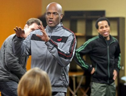 Besides his theater and film work, Kenny Leon (center, in rehearsal), is known for wearing athletic shoes with every outfit.