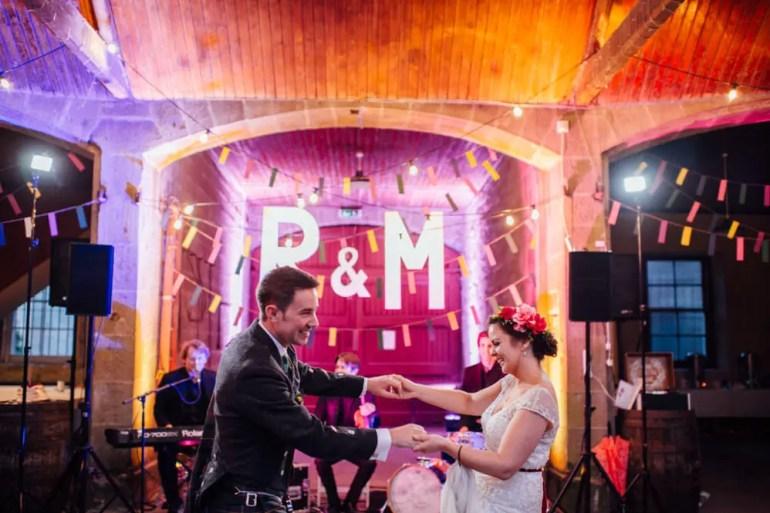 Wedding couple dances to Triple Scotch Ceilidh band