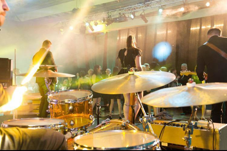 Encore band, The Edge, providing a headline performance at an event.