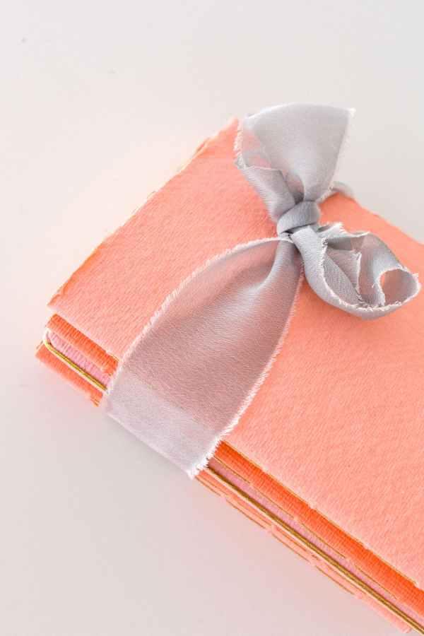 cuadernos de notas de bolsillo tono coral