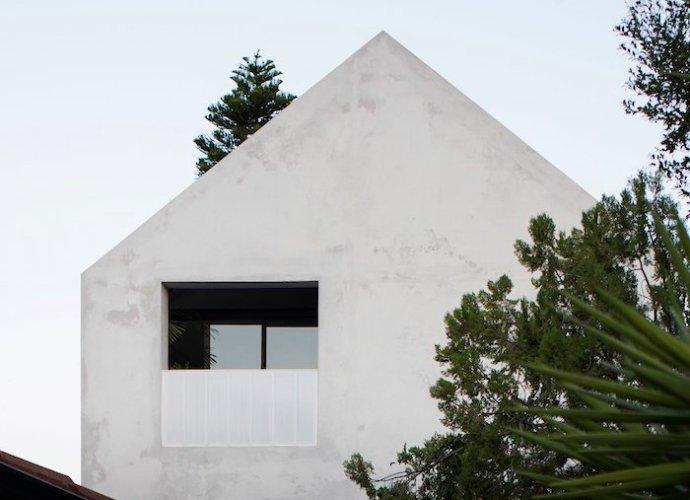 Whispering Smith house - concrete, wood, whitewashed recycled brick
