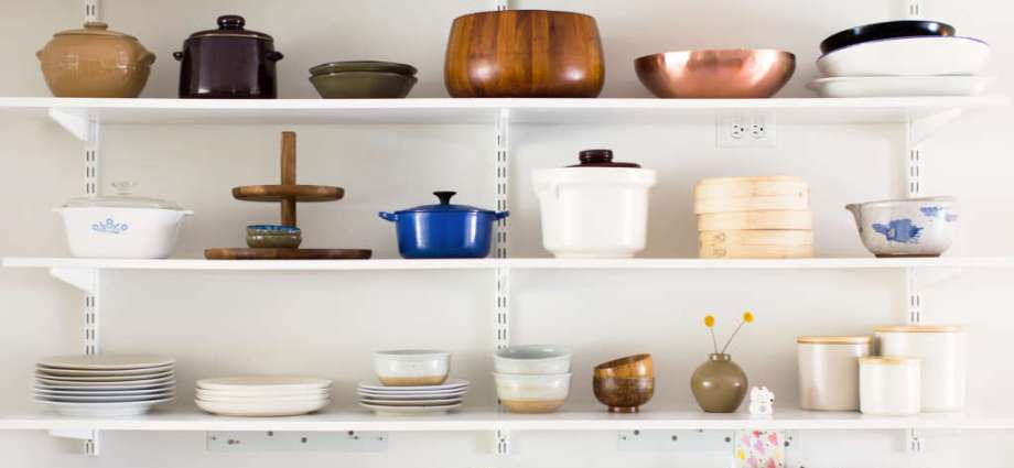 Horizontal shelves containing neatly arranged kitchen objects.