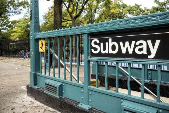Helvetica sign on subway entrance in New York