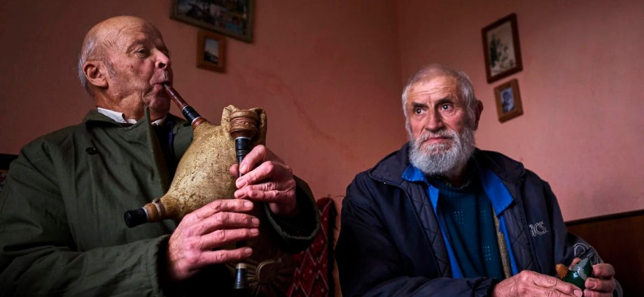 Two old men sitting in a room in 7 Travel Photography Tips You Don't Usually Hear
