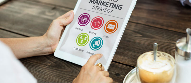 Man holding iPad displaying a marketing strategy