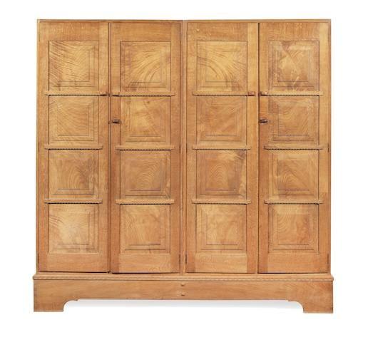 Peter van der Waals (British Dutch, 1870-1937) An Oak Four Door Wardrobe, circa 1930
