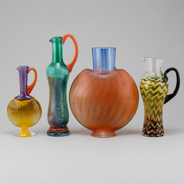 Three glass jugs and a vase, made for Kosta Boda designed by Kjell Engman.