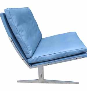 Lounge chair with blue upholstery designed by Jørgen Kastholm & Preben Fabricus.