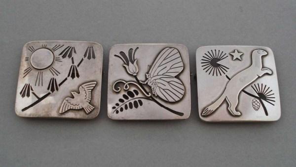 Set of three silver brooches by Arno Malinowski