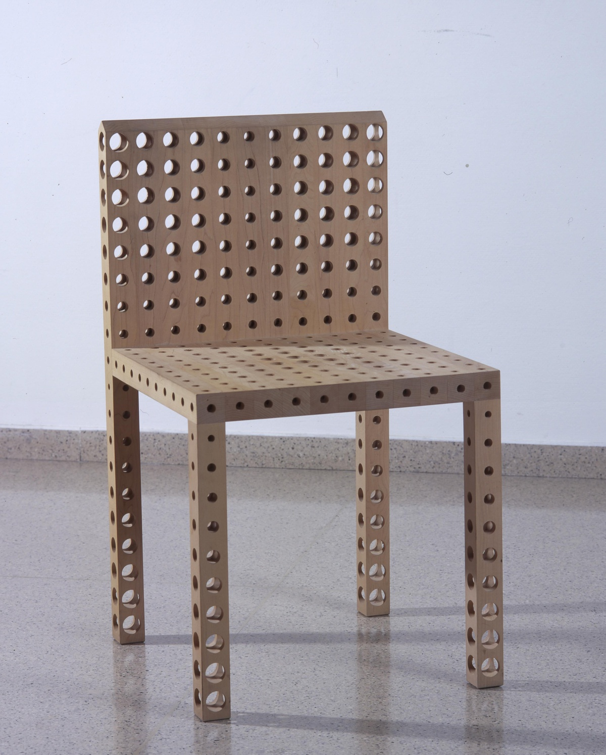 Seat with holes designed by Gijs Bakker (1989)