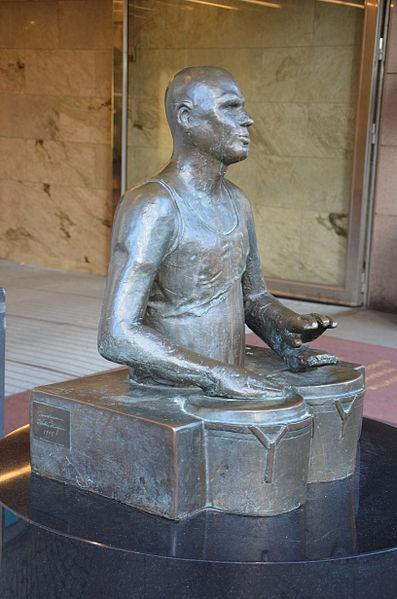 Trumslagaren by Hertha Hillfon, bronze, 1995, in front of PUB, Hötorget, Stockholm