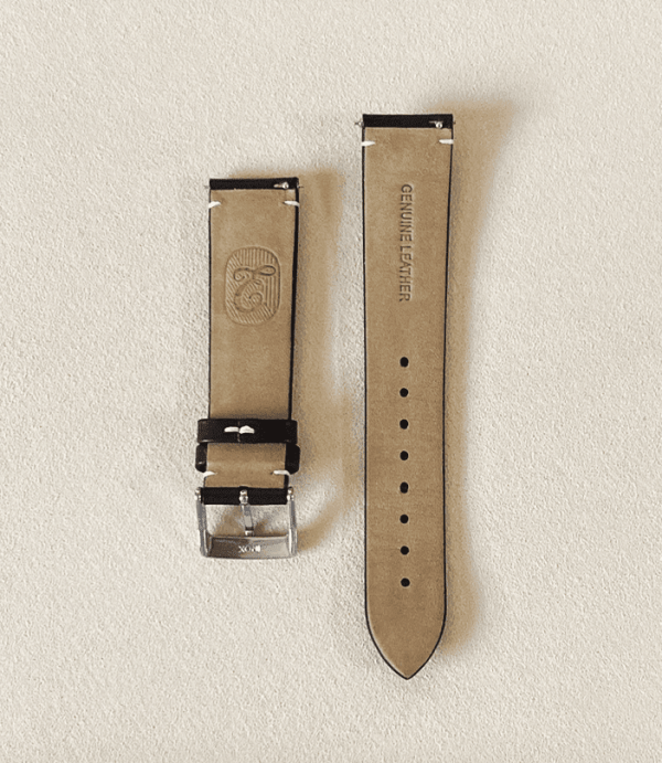 Genuine calf leather, vegetable tanned black watch strap featuring a tongue buckle and quick release pin