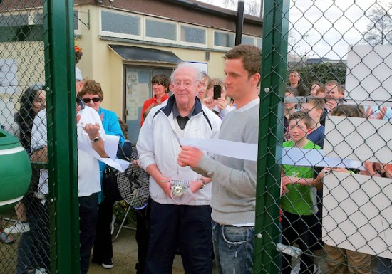 Andy King cuts the ribbon to officially open the club's three new artificial grass courts