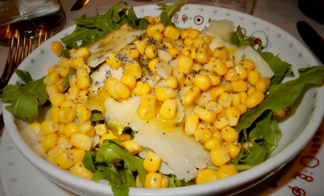 Armando al Pantheon Insalata Fantasia. Arugula salad with corn, parmesan, currants, and hazelnuts.