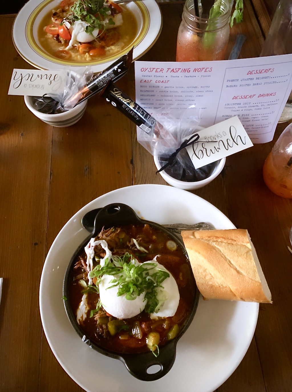 Poached egg braised beef and Bloody Mary brunch