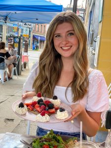 Tori holding mixed berry crepe
