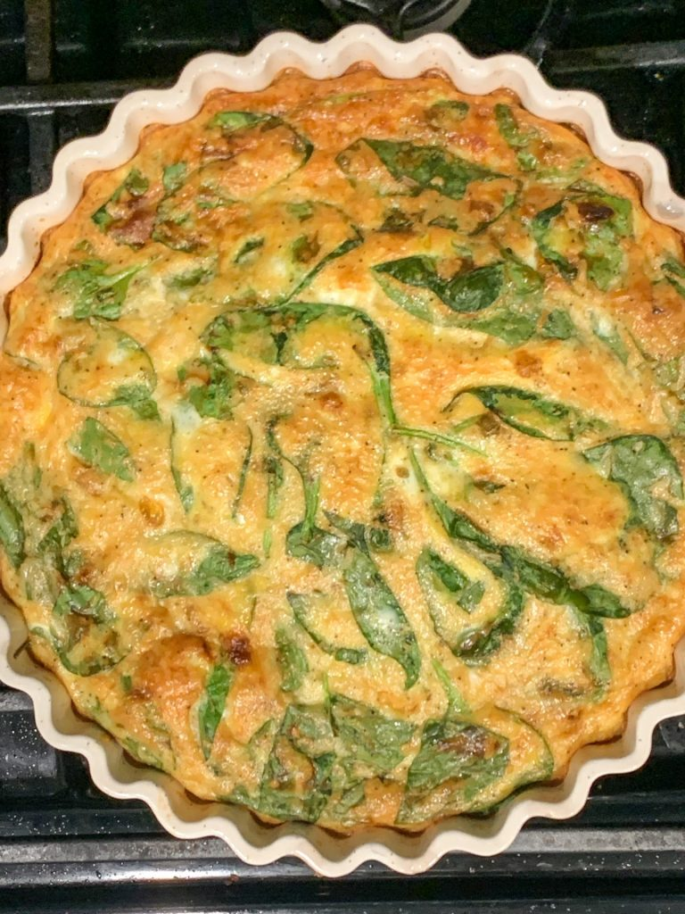 Crustless french onion and spinach quiche right out of the oven and ready for brunch