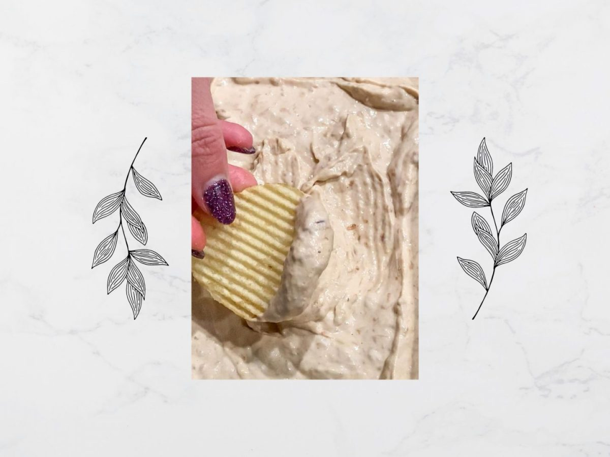 Tori dipping a ruffles trip into a homemade french onion dip surrounded by two decorative leaf stencils