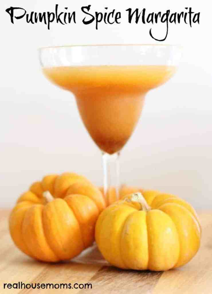 Pumpkin Spice Margarita with two small pumpkins