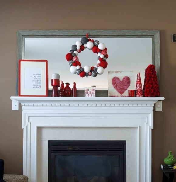 This Valentine's Day mantel is made up almost entirely of decorations that were also used at Christmas! And there's a free printable included!