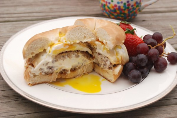 A Philly Cream Cheese-stuffed sausage patty topped with a Kraft Single & a fried egg, served on a toasted bagel with Miracle Whip. #SayCheeseburger #shop