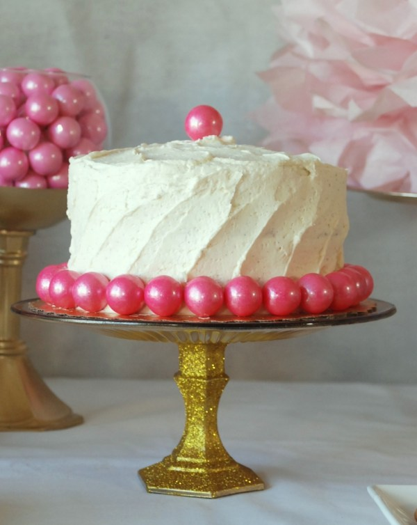 Transform a Dollar Store glass plate and candlestick into a beautiful gold glitter cake stand!