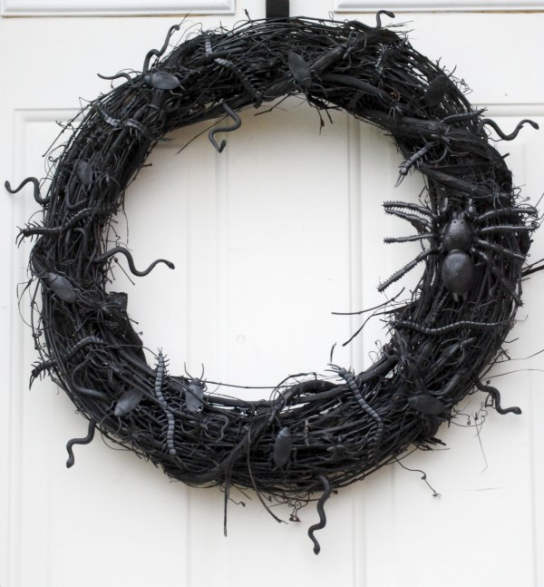 Spray paint a grapevine wreath black, glue on some plastic bugs and spiders, and you have yourself a creepy crawly Halloween wreath!