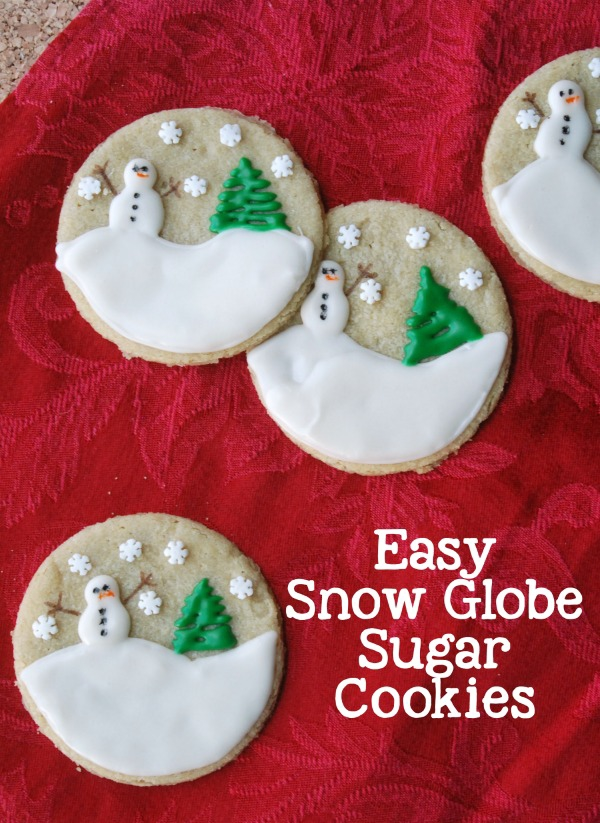 How cute are these snow globe sugar cookies?? They look so complicated, but the step-by-step directions make them so easy. And they're made with Nestle Rolled & Ready #CookieDoughSheets, so they can be made in no time at all. Totally pinning this to make these every year! #TollHouseTime #NestleTollHouse