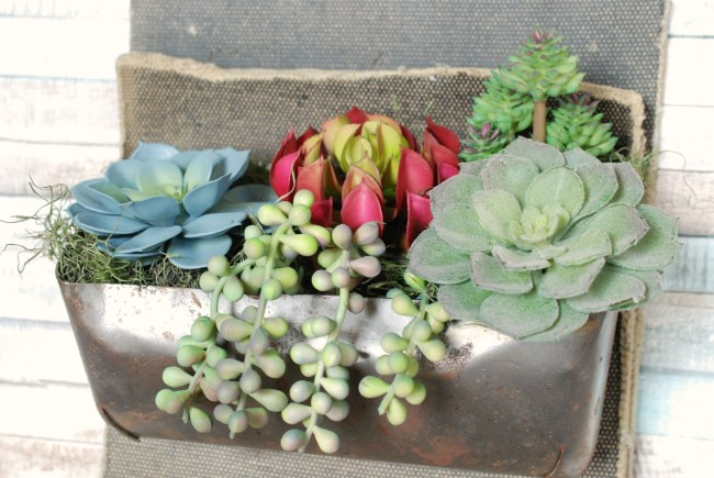 Make this rustic succulent planter using faux succulents from the craft store.