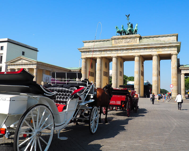 Horse and Carriage in front of the Brandenburg Gate in Berlin
