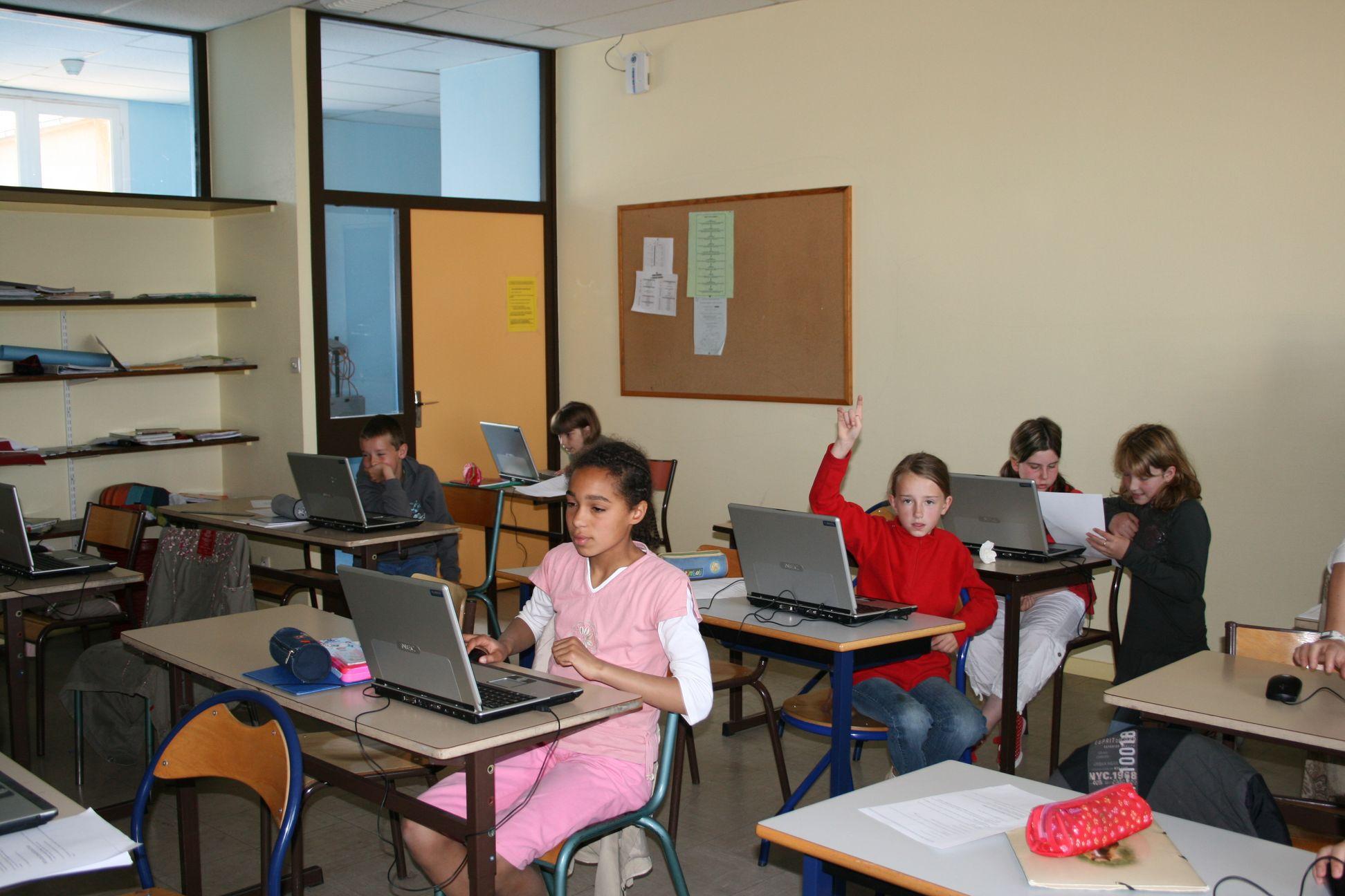 Un PC portable chacun pour créer son document Word