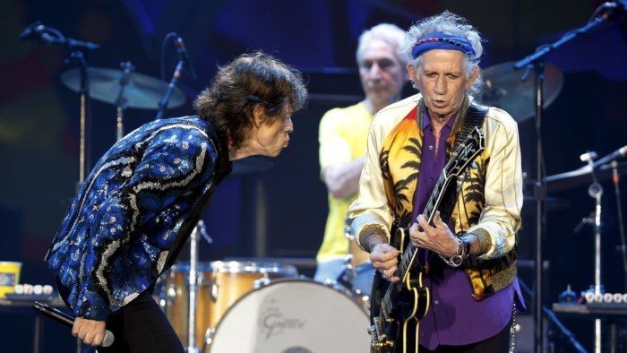 """British veteran rockers The Rolling Stones' guitarist Keith Richards performs next to Mick Jagger and Charlie Watts during a concert on their """"Latin America Ole Tour"""" at Morumbi stadium in Sao Paulo"""