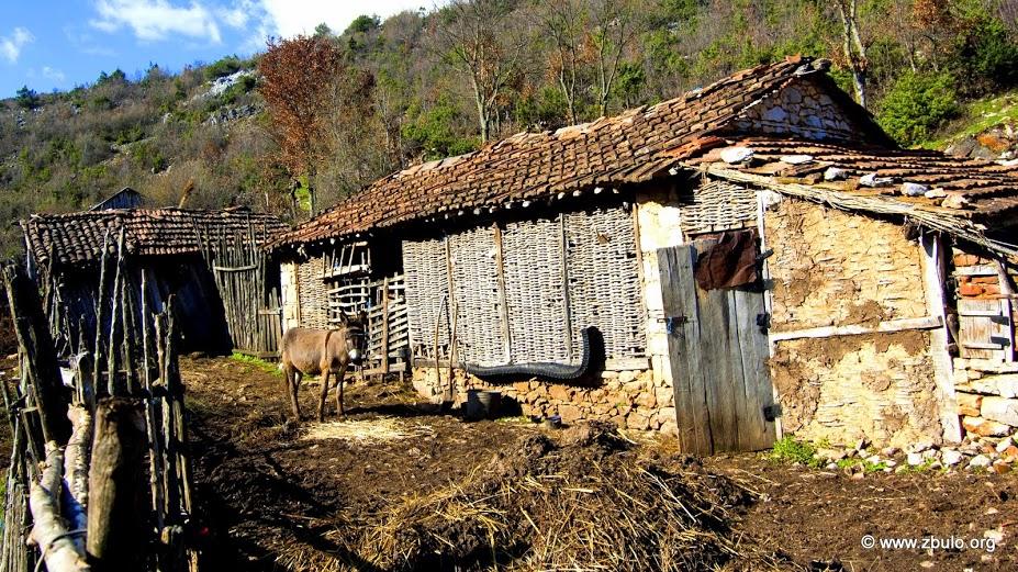 Mud brick walls at a stable at the outskirts.
