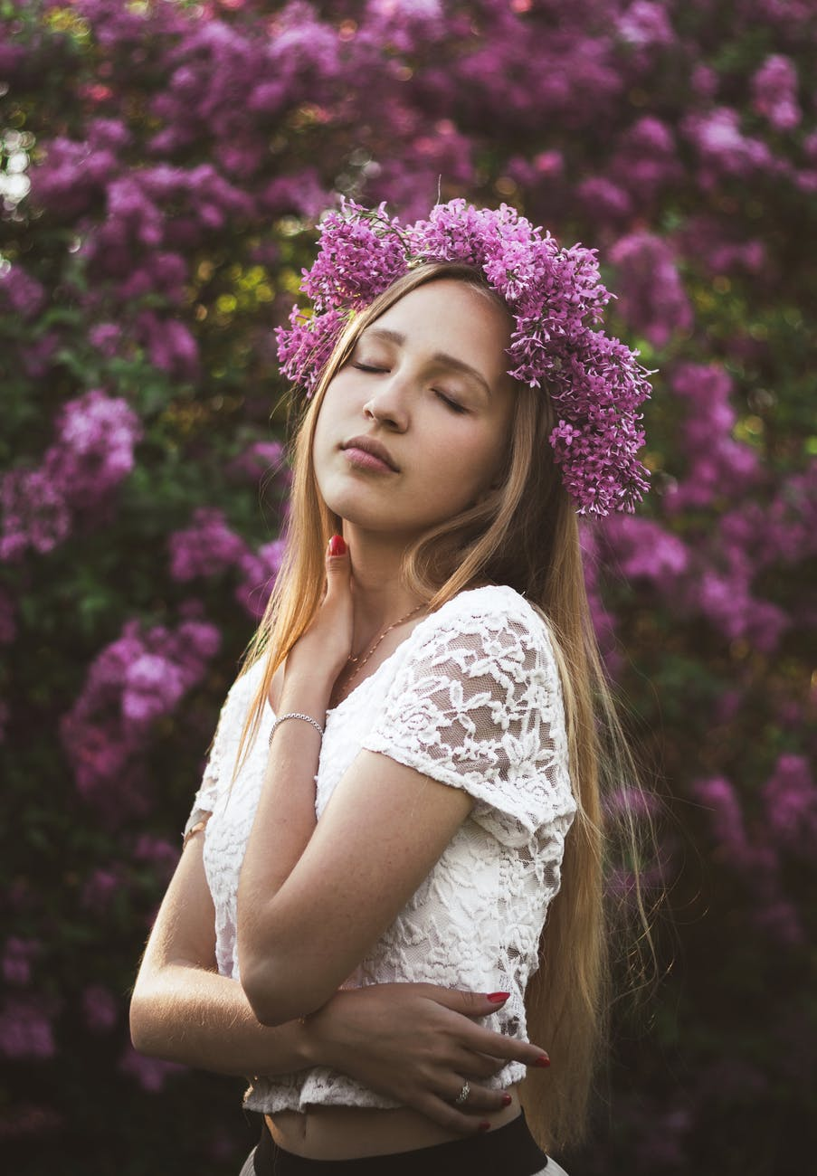 charming woman with wreath on head and closed eyes