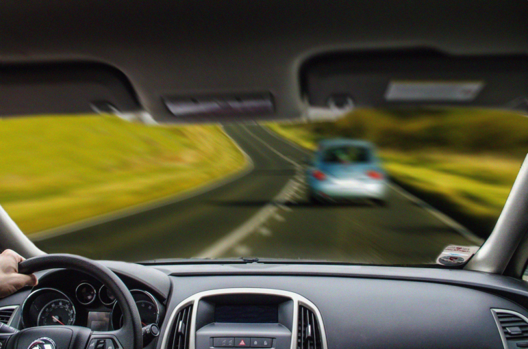 looking through the front windshield of a moving vehicle