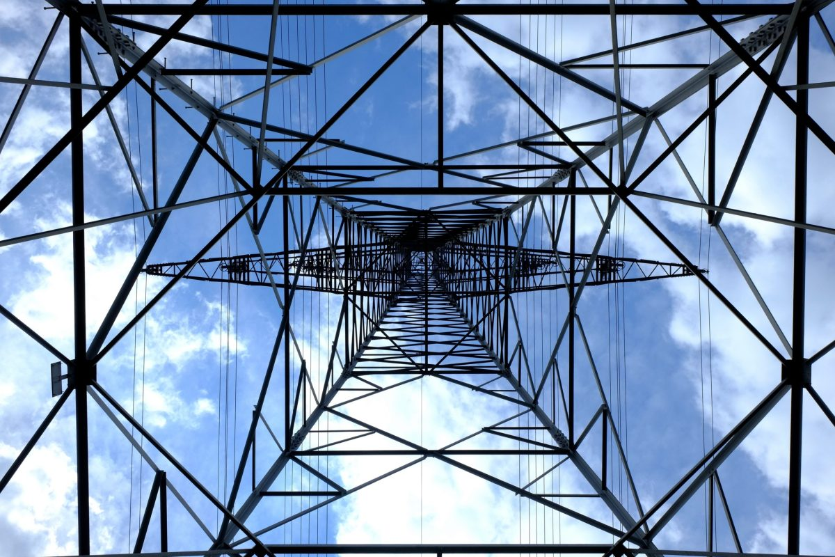 Looking up from underneath a transmission tower.
